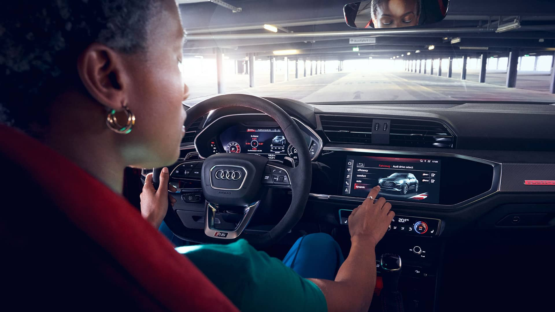 Driver operates the MMI system in the Audi RS Q3